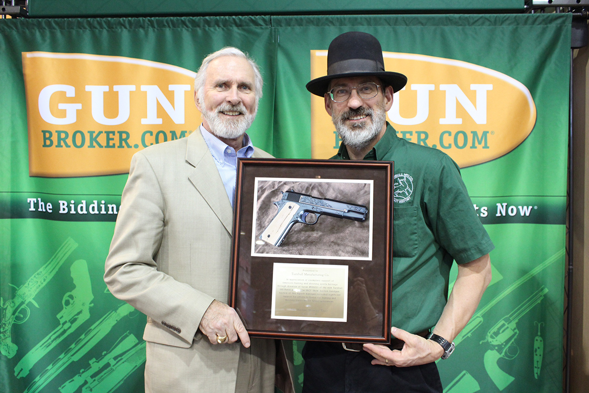 Doug Turnbull receives a plaque honoring Turnbull Manufacturing's contribtutions to the Hunting Heritage Trust Auctions from Bob Delfay.