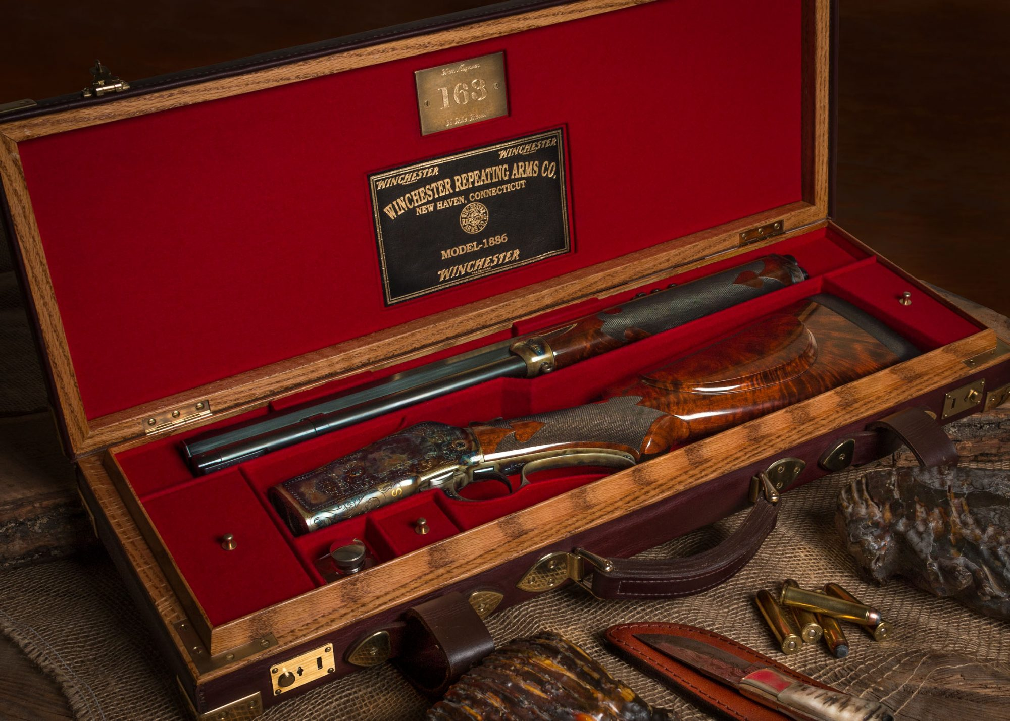 Restored, converted and upgraded antique Winchester 1886 in .50-110. Red felt lined oak and leather case reworked by David Bennett.