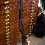Photo of fire damaged Winchester Model 1894 Deluxe Takedown, a candidate for firearm restoration