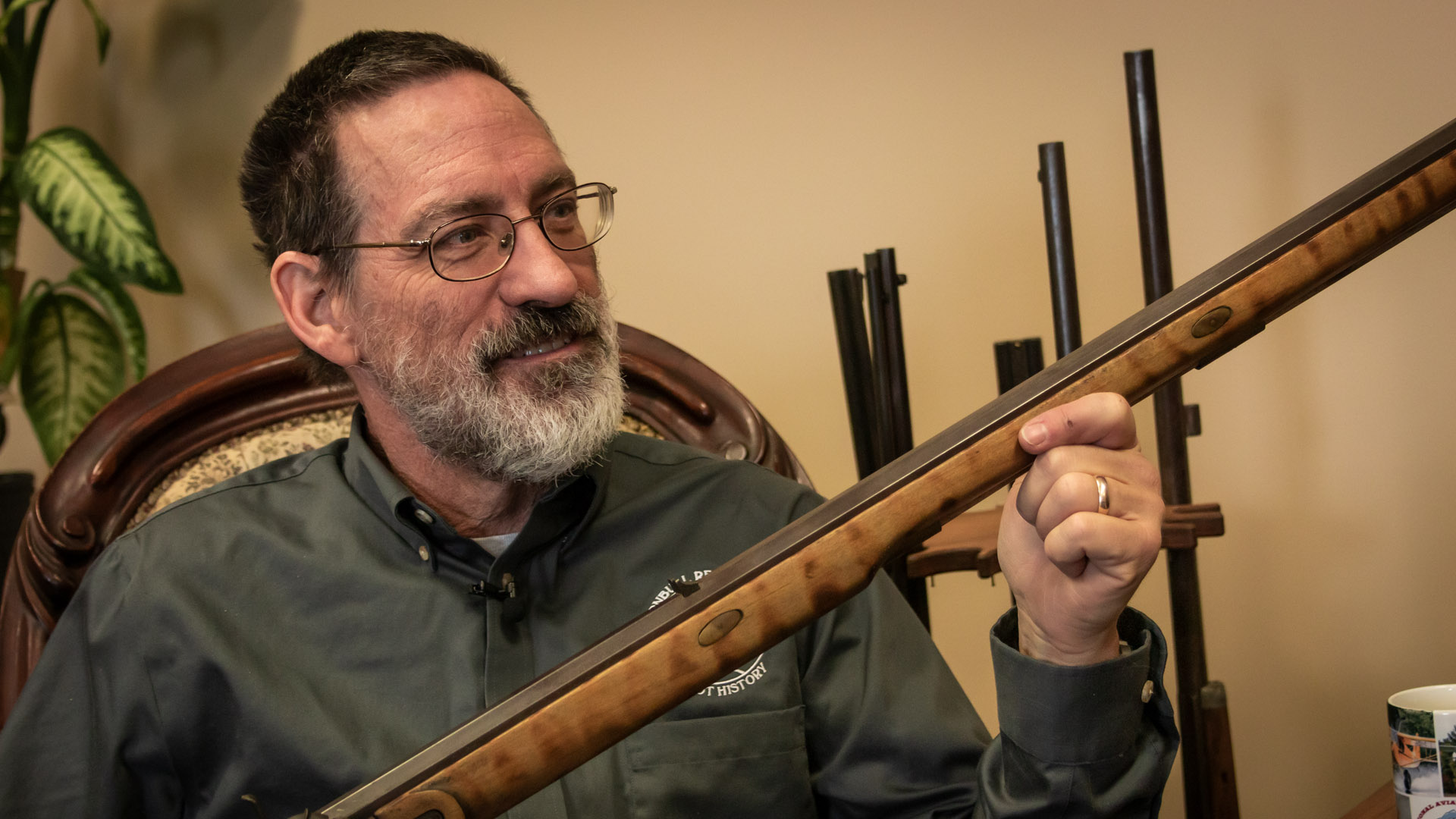 Photo of Doug Turnbull showing a muzzleloader rifle that he built from a kit when he was 12 years old