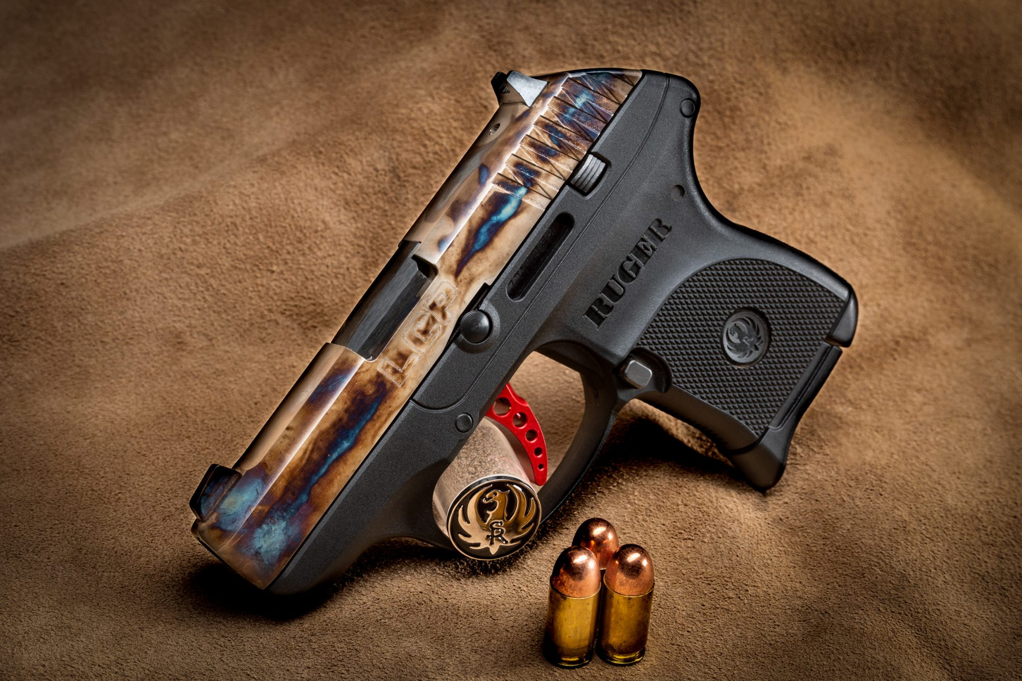 Photo of a factory-new Ruger LCP, featuring bone charcoal color case hardened slide by Turnbull Restoration