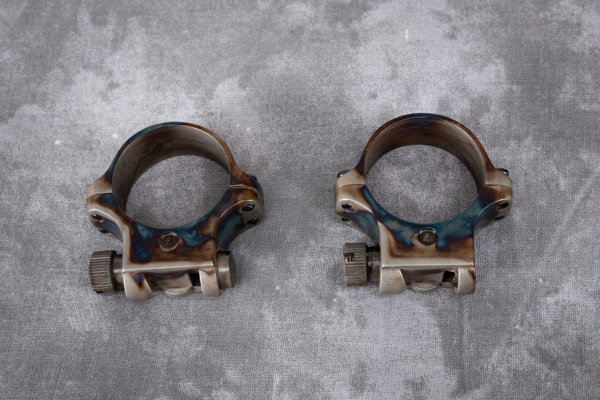 Photo of color case hardened scope rings by Turnbull Restoration