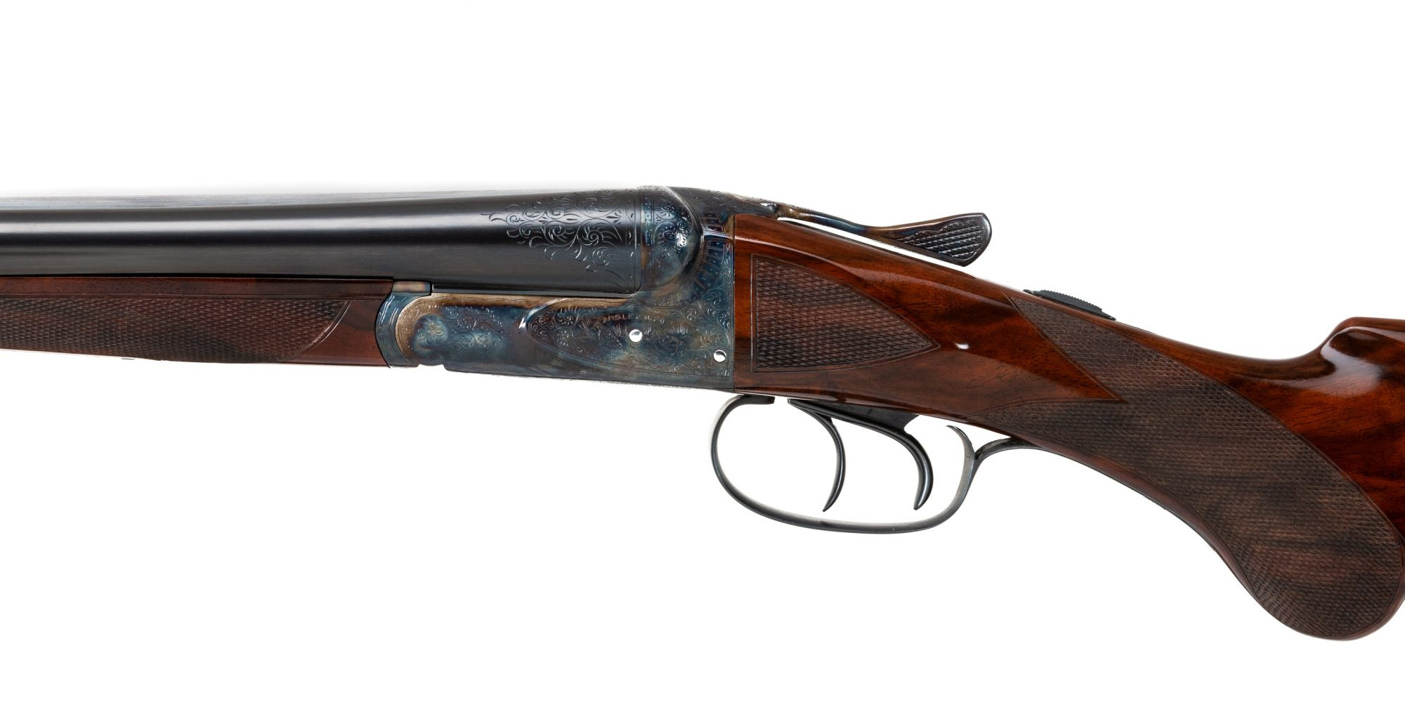 Photo of a restored A.H. Fox CE 20 gauge shotgun, featuring color case hardening by Turnbull Restoration