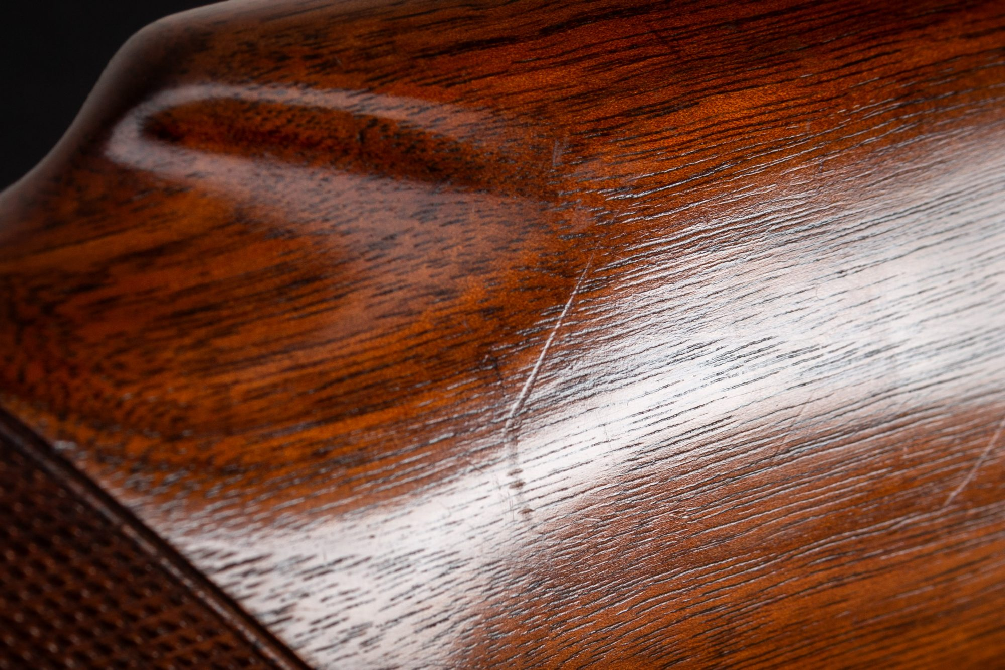 Photo of scratches on a pre-owned Winchester Model 12 pump action 12 gauge shotgun, sold as-is by Turnbull Restoration
