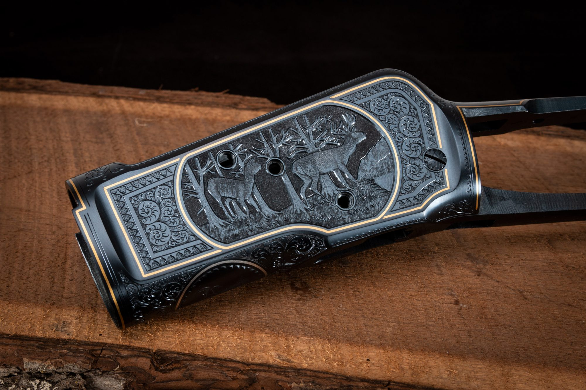 Photo of engraved and charcoal blued receiver on a fully restored Winchester Model 1892 from 1914, performed by Turnbull Restoration in Bloomfield, NY
