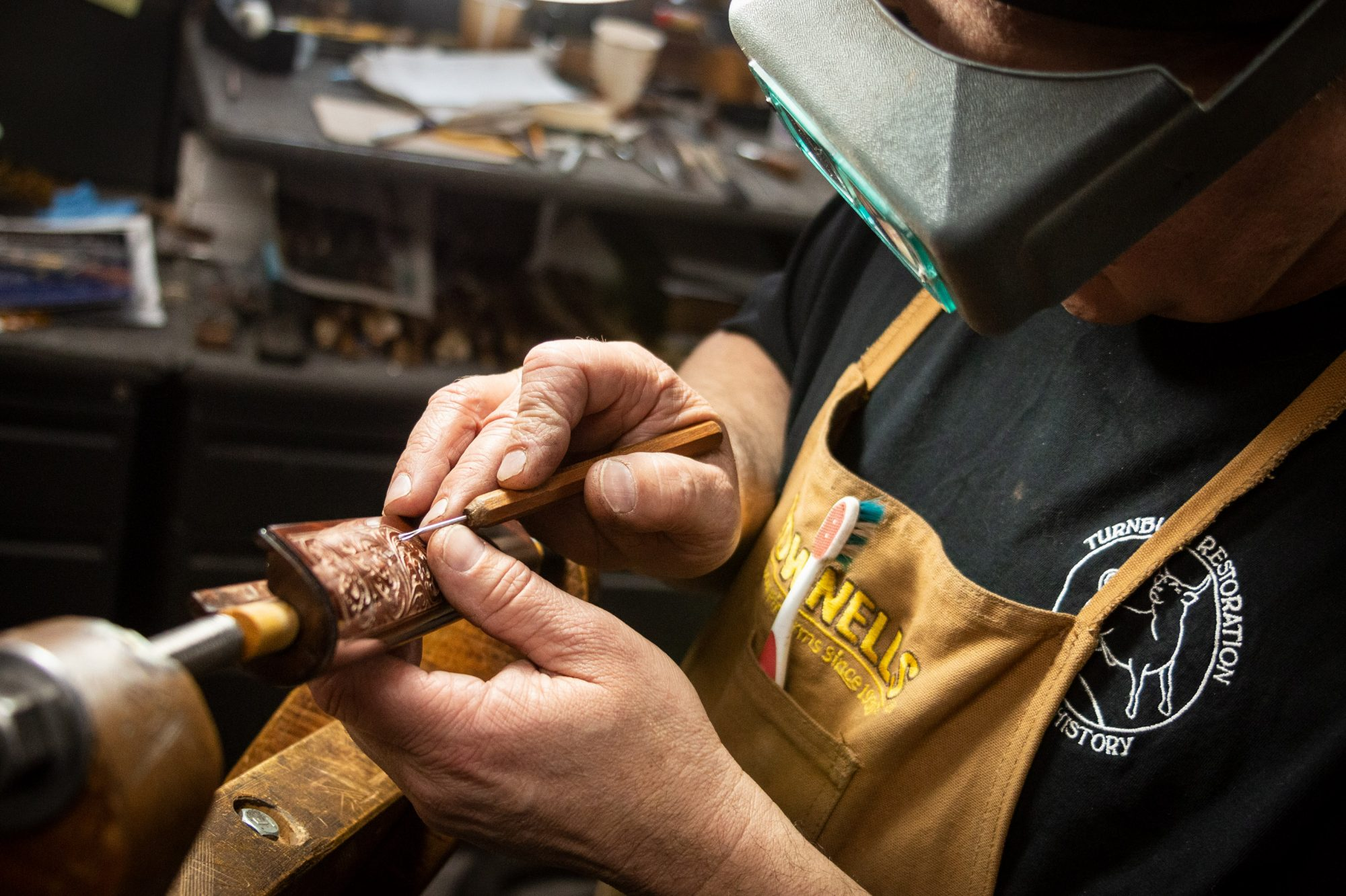 Photo of forend carving on a fully restored Winchester Model 1892 from 1914, performed by Turnbull Restoration in Bloomfield, NY