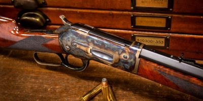 Photo of a Winchester Model 1886 reproduction by Turnbull Restoration, featuring period-correct color case hardening, charcoal bluing and rust bluing