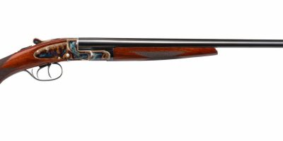 Photo of a pre-owned L.C. Smith Field Grade .410 gauge shotgun featuring bone charcoal color case hardening by Turnbull Restoration