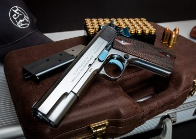 Photo of a new, Turnbull-manufactured Commercial Model 1911 featuring period-correct charcoal bluing and nitre bluing