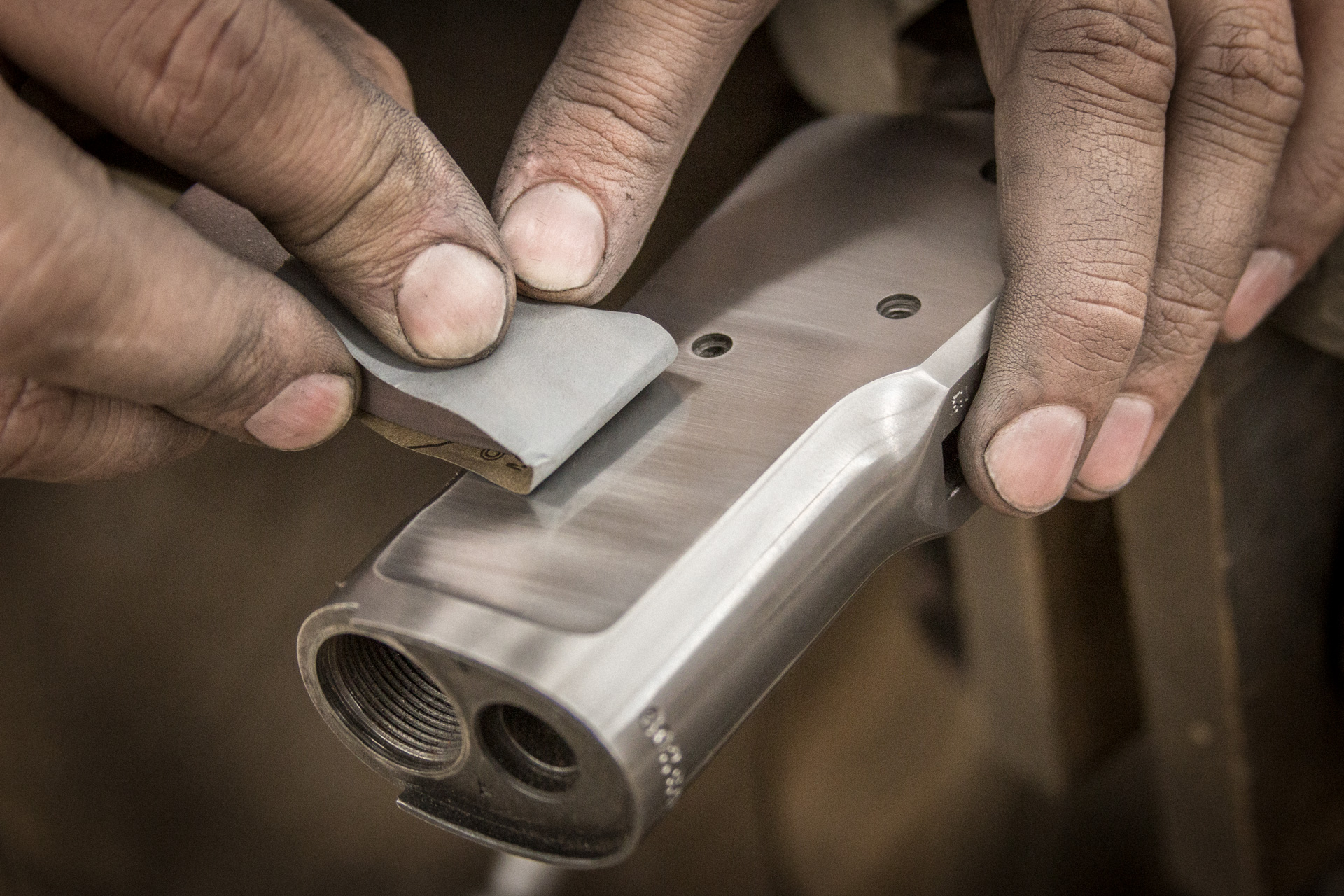 Photo of a Winchester 1892 receiver being polished as part of a gun restoration process