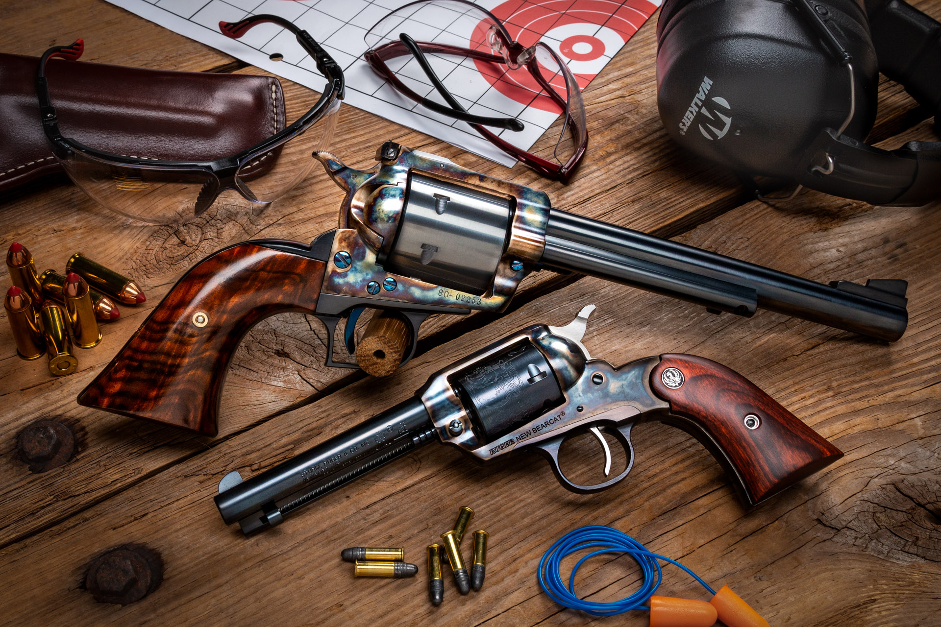 Photo of a Ruger Super Blackhawk and a Ruger New Bearcat, featuring bone charcoal color case hardening by Turnbull Restoration of Bloomfield NY