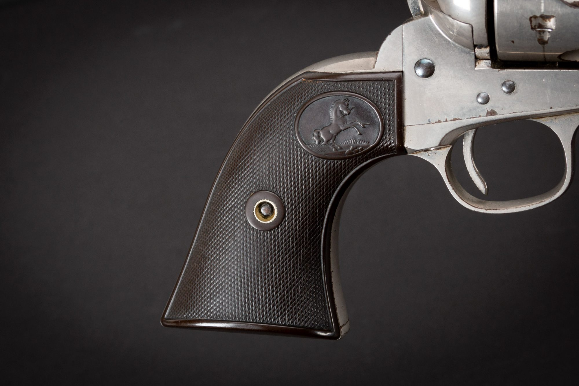 Photo of a first generation Colt Single Action Army revolver from 1897, with original nickel and nitre finishes