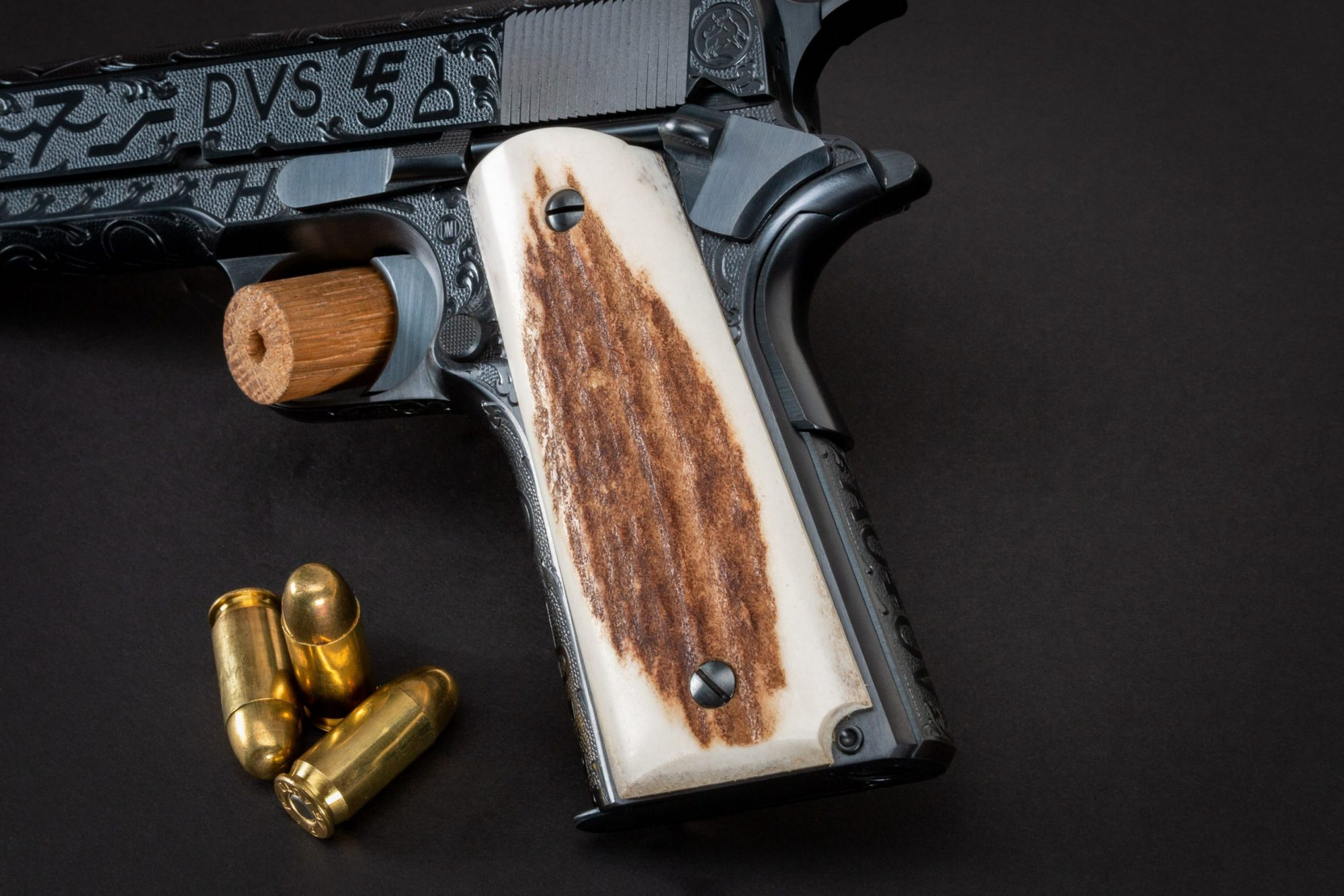 Photo of a Turnbull Restoration Model 1911, featuring cattle brand engraving and hand-fit elk grips