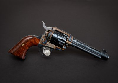 Photo of a Ruger New Vaquero revolver, featuring engraving and bone charcoal color case hardening by Turnbull Restoration of Bloomfield, NY