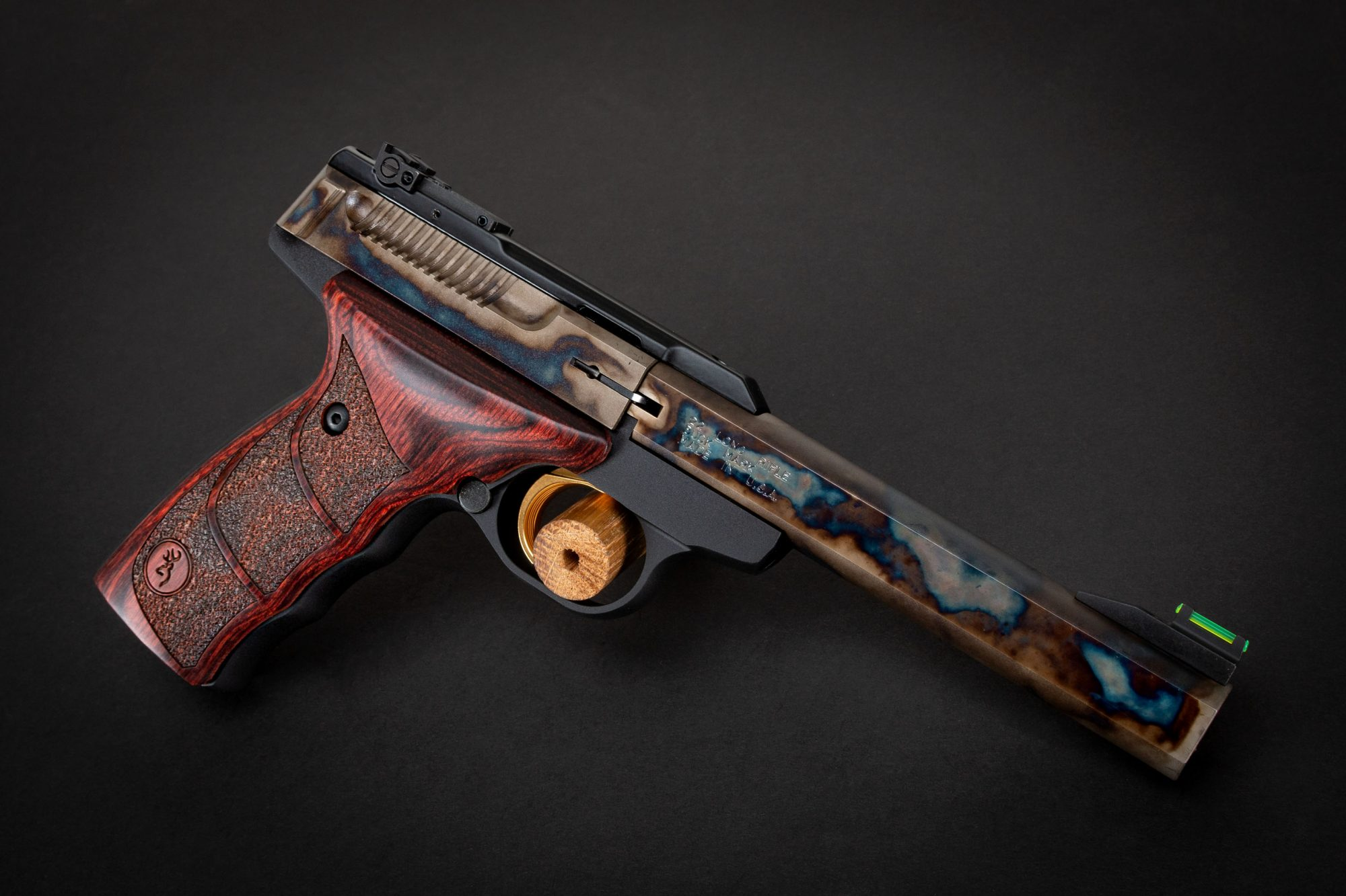 Photo of a Turnbull Finished Browning Buck Mark pistol in .22LR, featuring bone charcoal color case hardening by Turnbull Restoration of Bloomfield, NY