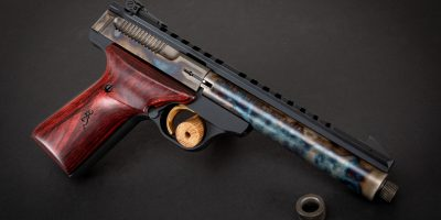 Photo of a Turnbull Finished Browning Buck Mark Field Target Suppressor Ready pistol in .22LR, featuring bone charcoal color case hardening by Turnbull Restoration of Bloomfield, NY