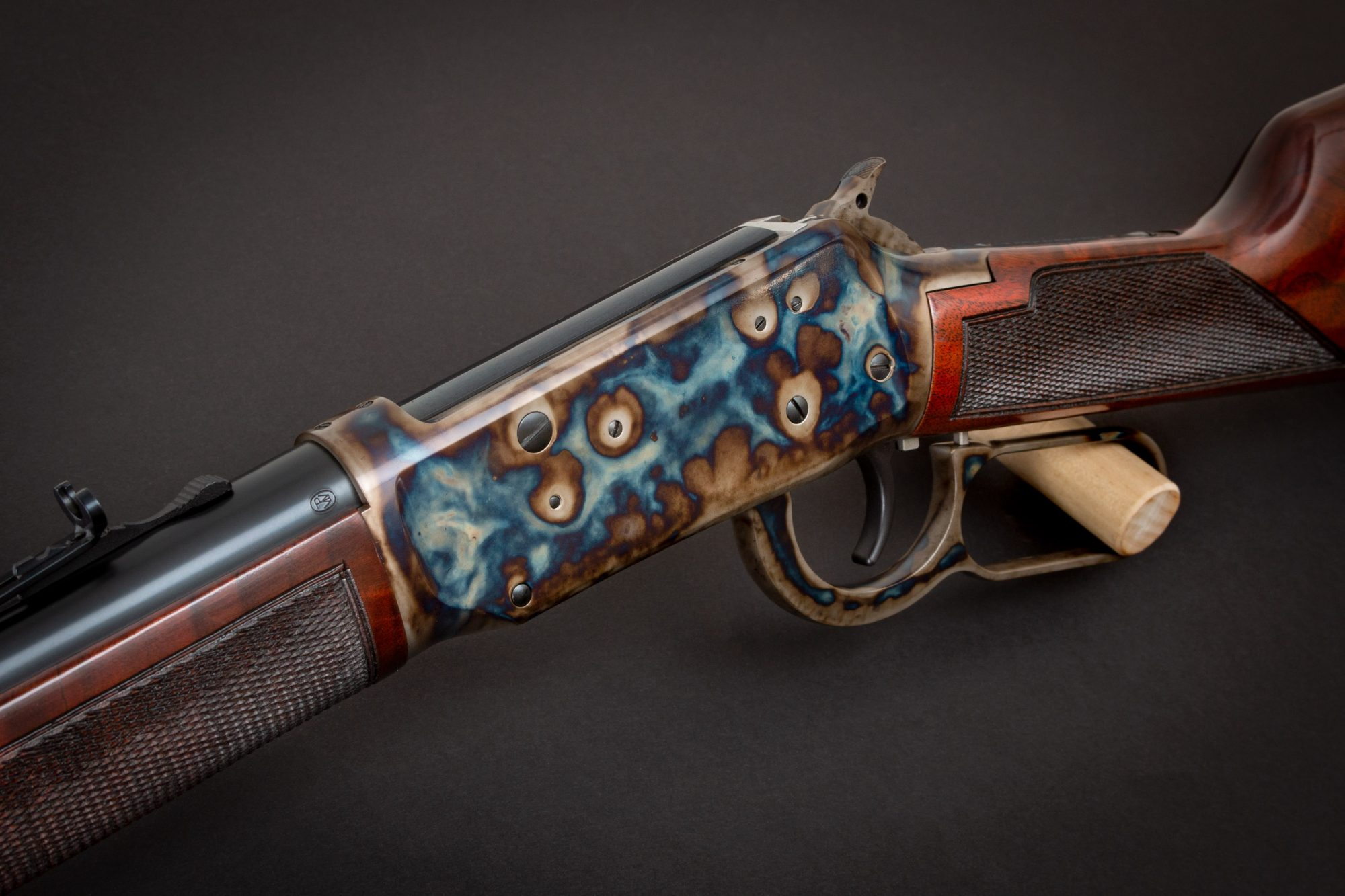 Photo of a refinished Winchester Model 1894 - The Turnbull Winchester 1894 features classic era metal finishes including bone charcoal color case hardening and refinished wood in Winchester red