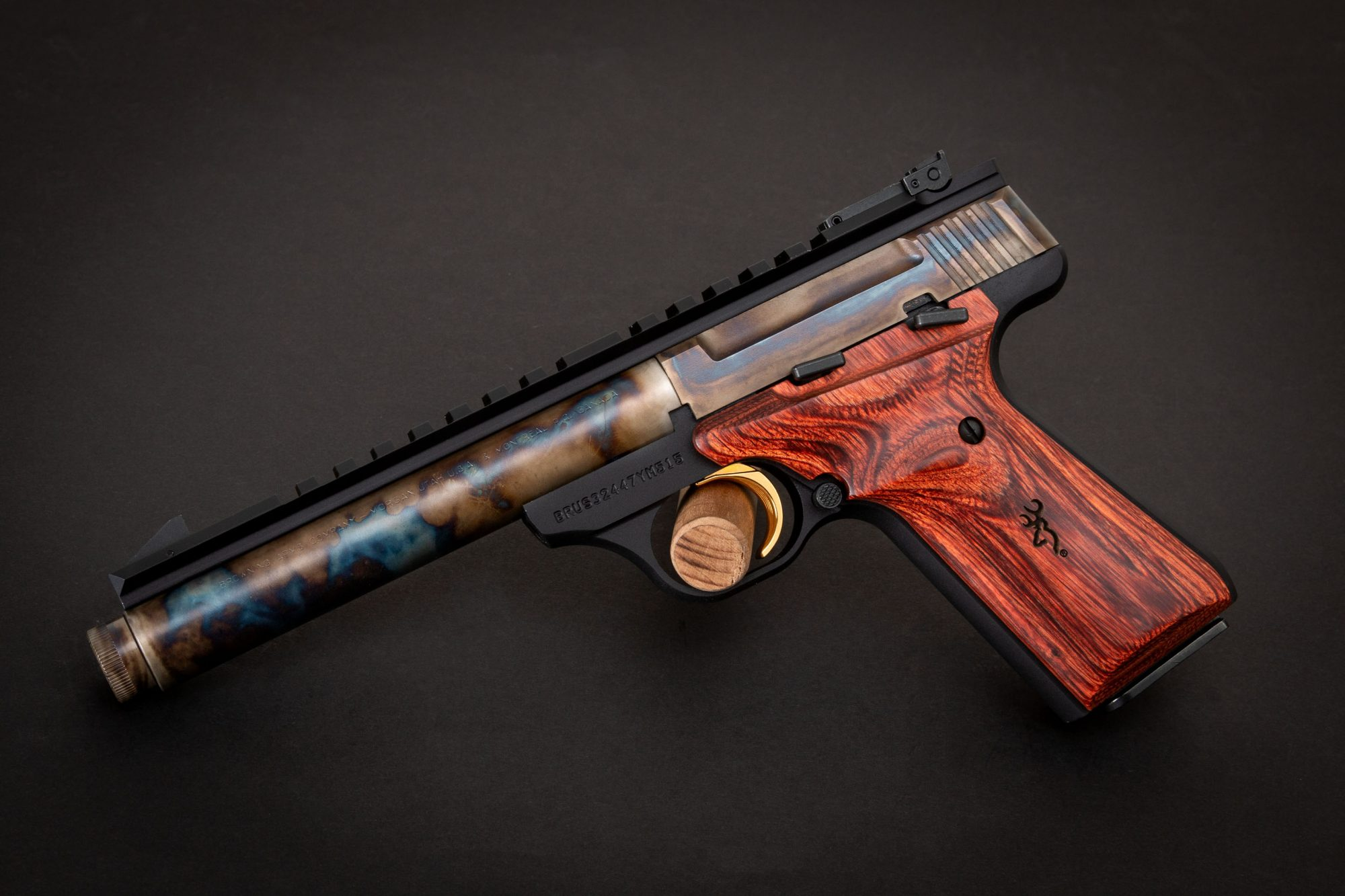 Photo of a color case hardened Browning Buck Mark Field Target with threaded barrel, featuring bone charcoal color case hardening by Turnbull Restoration of Bloomfield, NY