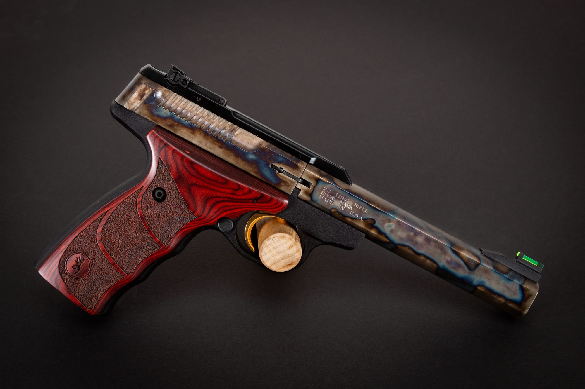 Photo of a color case hardened Browning Buck Mark pistol, featuring bone charcoal color case hardening by Turnbull Restoration of Bloomfield, NY