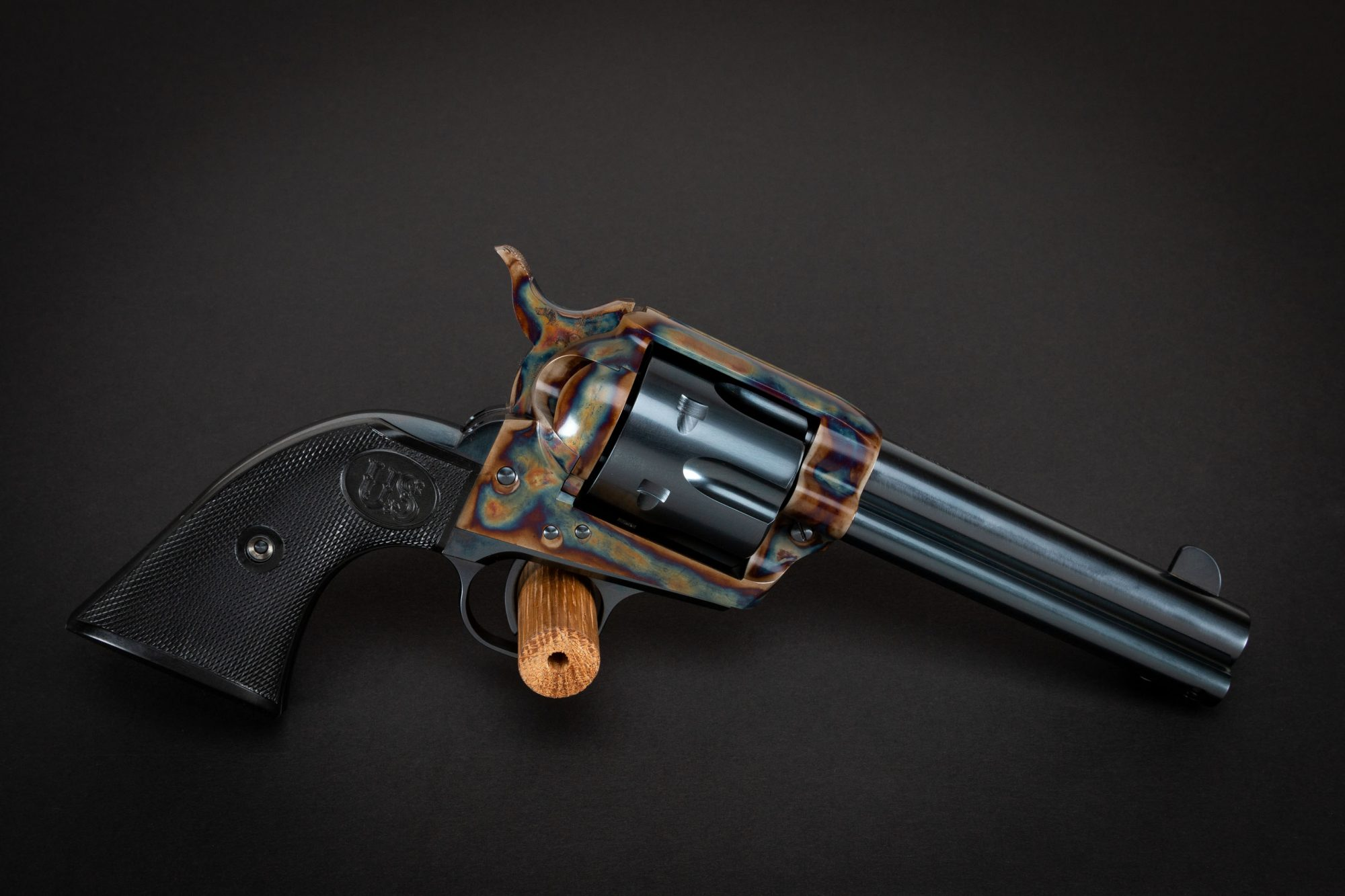Photo of a color case hardened U.S. Fire Arms SAA revolver, featuring restoration-grade bone charcoal color case hardening by Turnbull Restoration of Bloomfield, NY