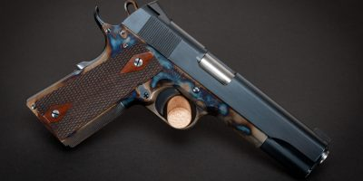 Photo of a Turnbull Government Heritage Model 1911, featuring color case hardened frame along with charcoal blued slide and parts