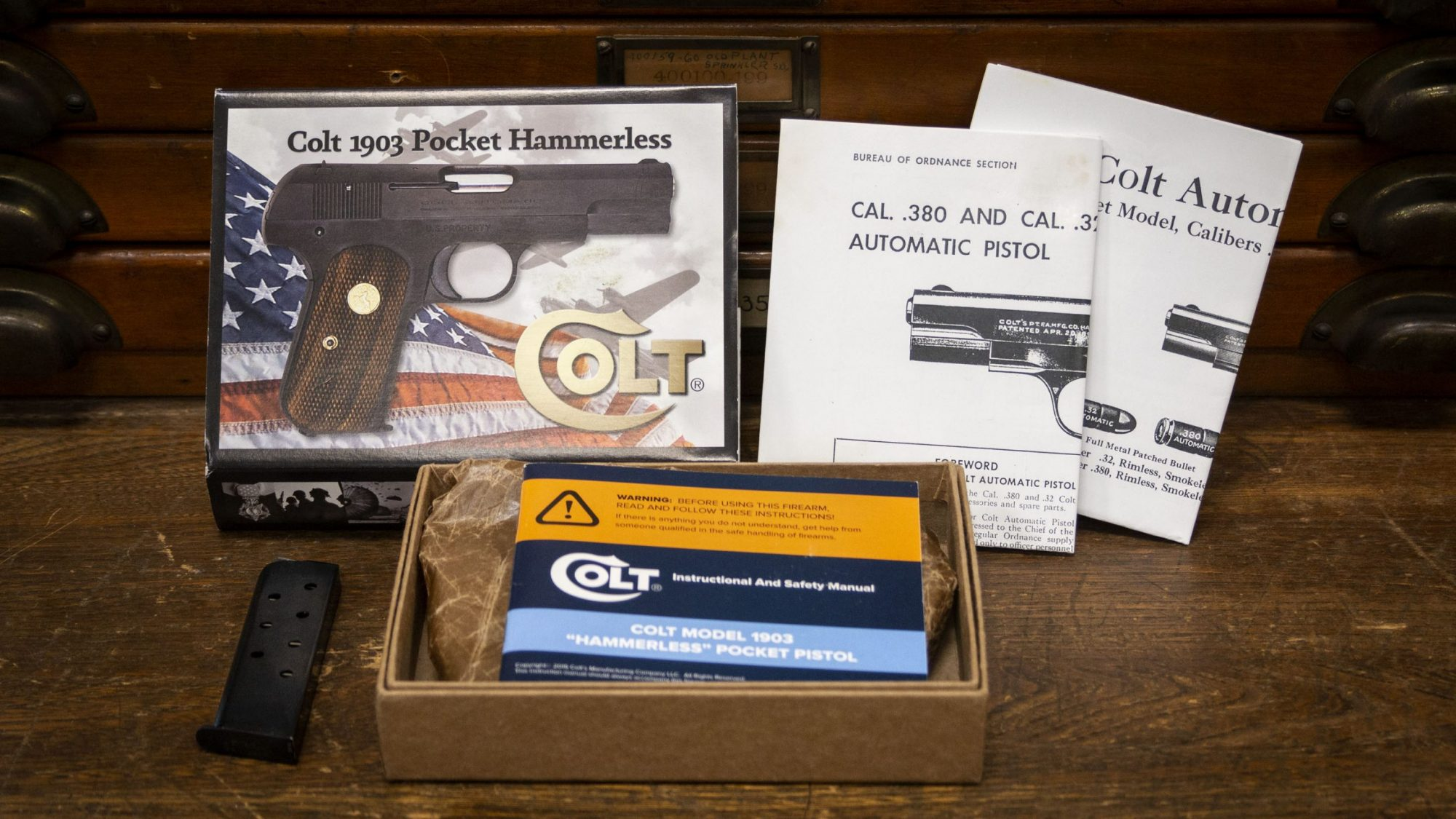 Photo of extras for a Colt Model 1903 Pocket Hammerless in .32 ACP, for sale by Turnbull Restoration of Bloomfield, NY