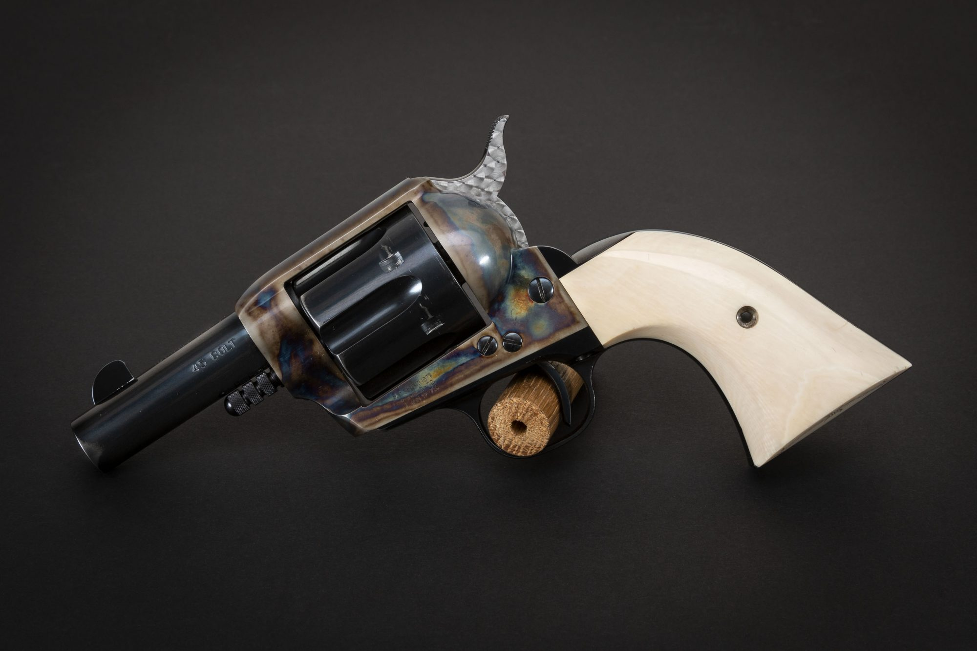 Photo of a U.S. Fire Arms (USFA) Single Action Sheriff Model Revolver featuring bone charcoal color case hardening by Turnbull Restoration of Bloomfield, NY