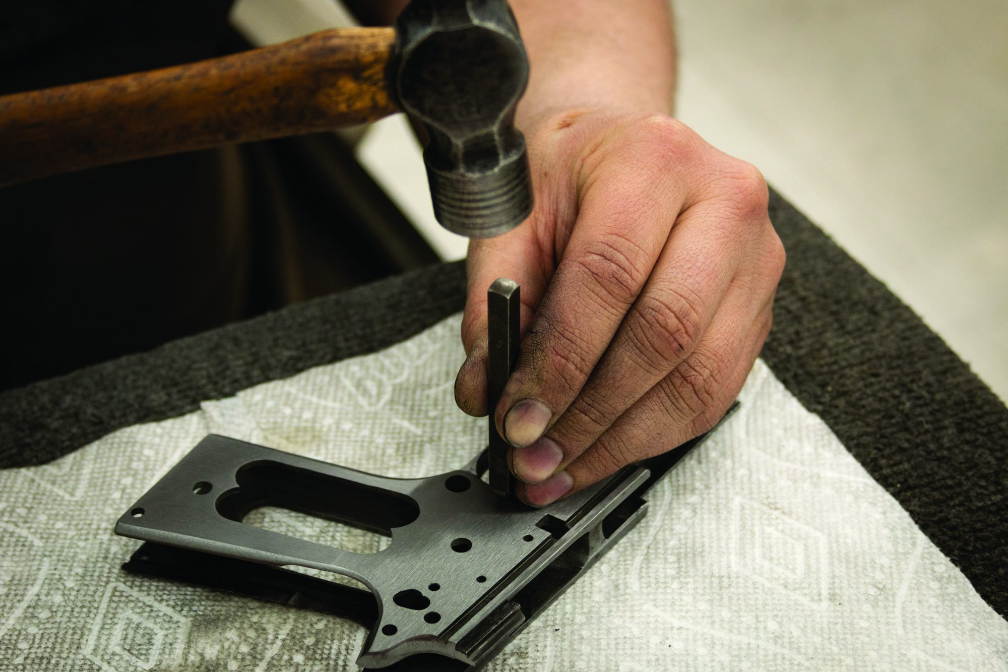 """Photo of a Colt Model 1911 being restored in the 1918-correct """"Black Army"""" style, by Turnbull Restoration of Bloomfield, NY"""
