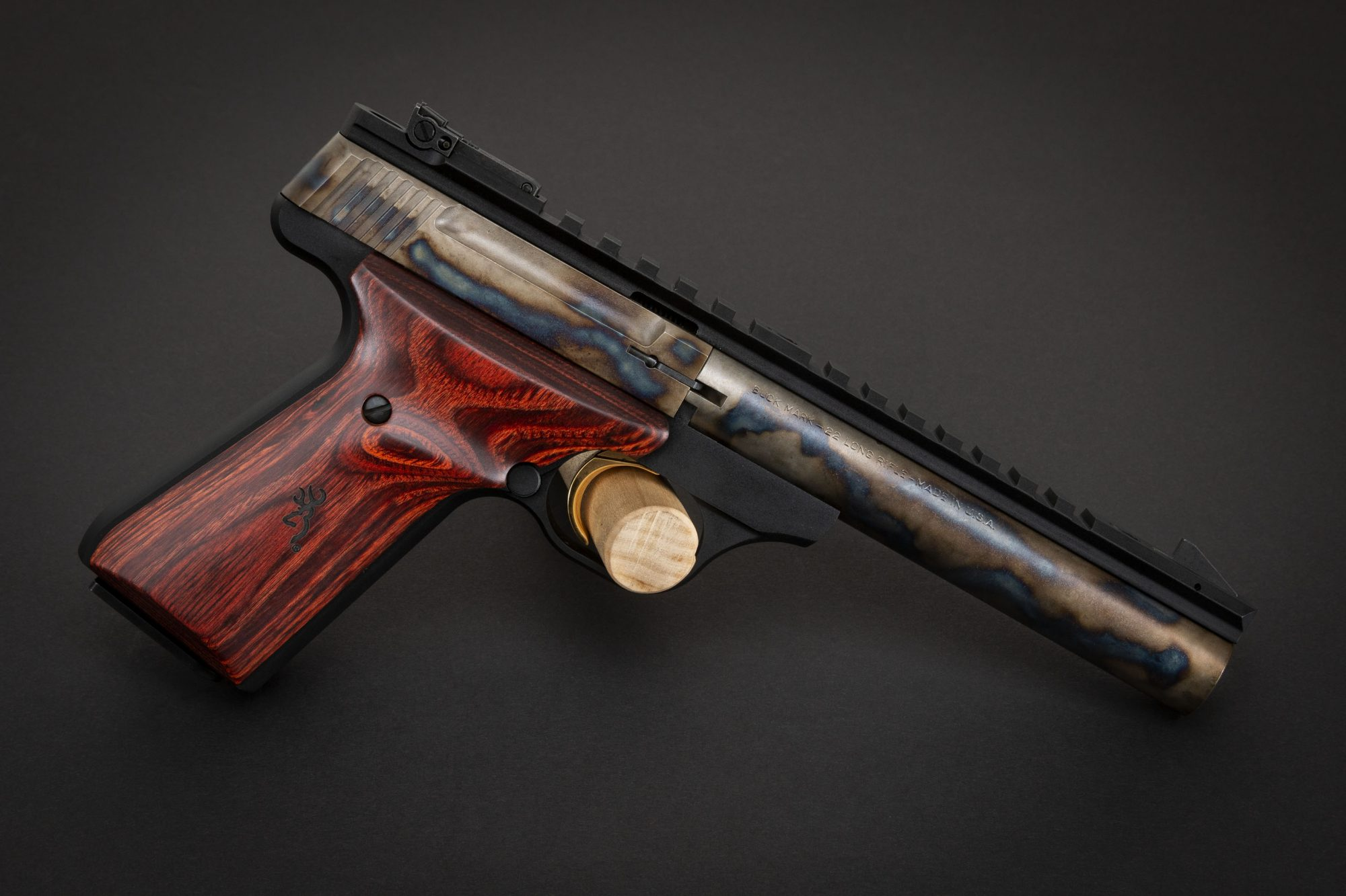 Photo of a color case hardened Browning Buck Mark Field Target pistol, featuring bone charcoal color case hardening by Turnbull Restoration of Bloomfield, NY