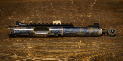 Photo of a color case hardened, threaded Ruger Mark IV barrel with Picatinny rail