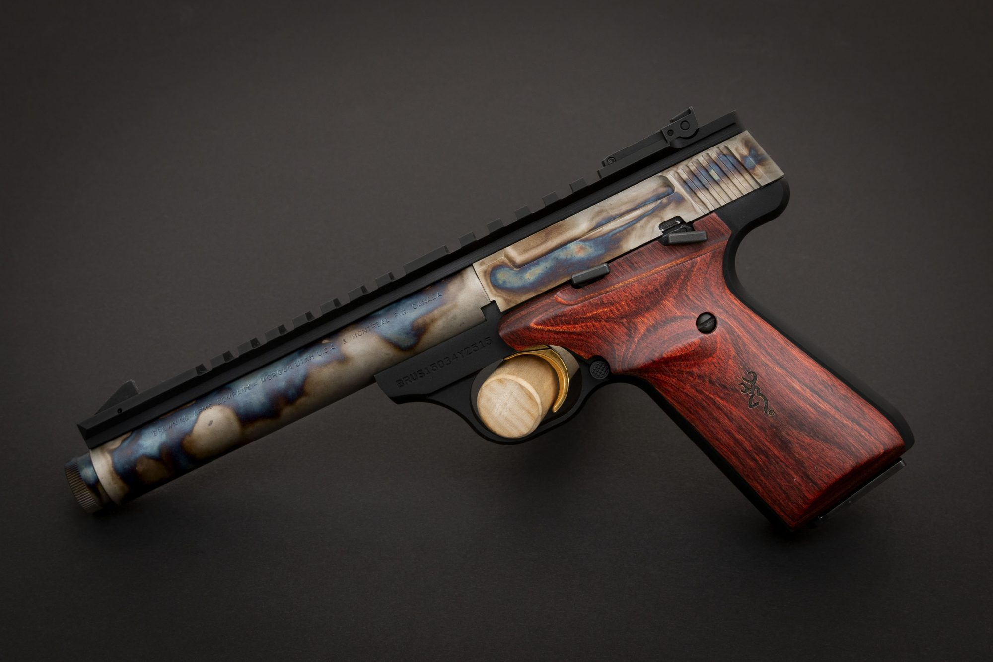 Photo of a color case hardened Browning Buck Mark Field Target Suppressor Ready pistol, featuring bone charcoal color case hardening by Turnbull Restoration of Bloomfield, NY
